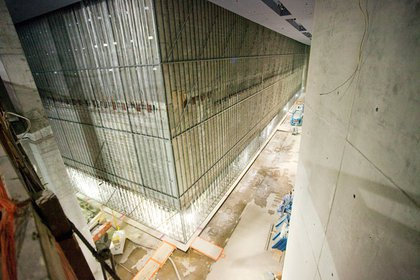 """From the entry way of the museum, we descend 80 feet to the base of the """"bathtub""""- here you can see the bottom of one of the memorial pools.  The museum is officially scheduled to be complete by Summer 2013, but rumor has it that it might be completed ahead of schedule, by the 2012 anniversary."""