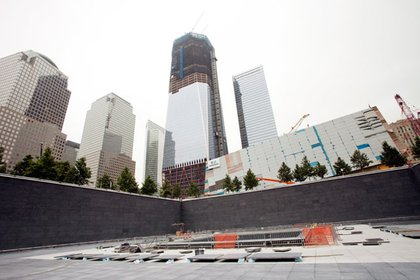 Looking back up towards 1 WTC from the south memorial pool- the museum pavilion is in the middle right.