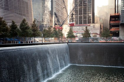 The fountains are very large: about an acre each, and 40' deep. 26,000 gallons of water flow through per minute, and the sound of all that water flowing over the edges is both loud and strangely calming. In background, work continues on the site of the future 2 and 3 WTC towers. Lots of construction is still going on along the edges of the site.