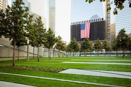 Looking across the grass lawn toward 1 WTC.