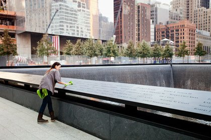 Employees from the company that fabricated the memorial panels were on hand to polish them up before the public arrived.