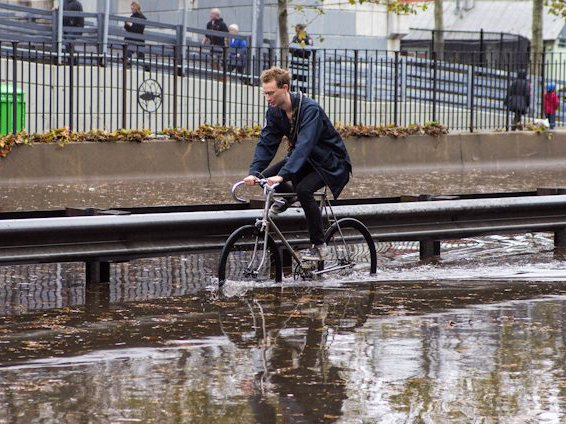 A man crosses a flooded portion of the FDR near 12th street.