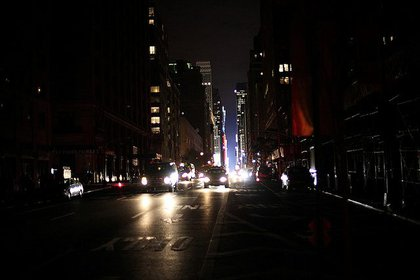 The cars keep coming from lit up Midtown.