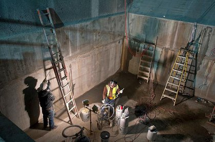 Working in the ventilation facility and station entrance on Eleventh Avenue between 33rd and 34th Streets.