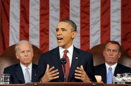 President Obama, with Vice President Biden and House Speaker Boehner behind him