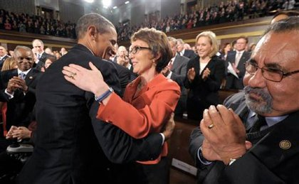 Obama greets Rep. Gabrielle Giffords, a year after she was shot