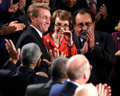 Giffords waved to colleagues in the House