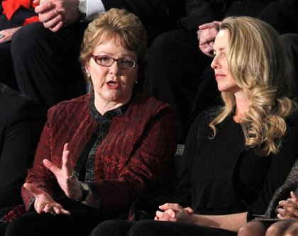 Bershire Hathaway Assistant—aka Warren Buffett's secretary—Debbie Bosanek, left, talks with Steve Jobs widow Laurene Powell Jobs