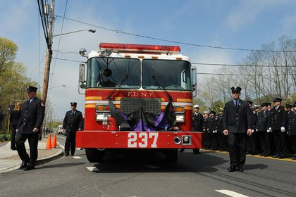 Firefighters escort the caisson during the funeral procession for Lt. Richard Nappi from Engine 237