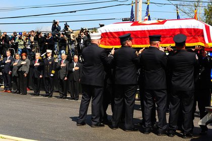 Nappi's casket is brought down into the church