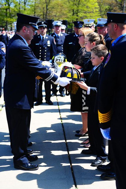 Lt. Richard Nappi's family, including his wife, Mary Anne, daughter, Catherine, and son, Nicholas, receive the officer's helmets