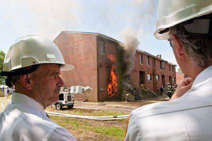 Fire Commissioner Cassano observes the fire at the back of the house