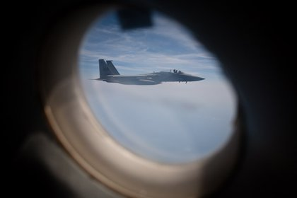 Through the door window, a F-15 hangs out for a photo-op.