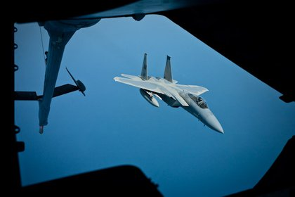 The F-15 from the 104th Fighter Wing approaches the KC-10's boom.