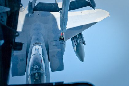 The F-15 connected to the refueling boom. Each fighter jet received approximately 2000 lbs of fuel (about 295 gallons), which only takes 15-20 minutes.