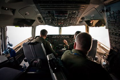 The cockpit of the KC-10 with the pilot, co-pilot and flight engineer.