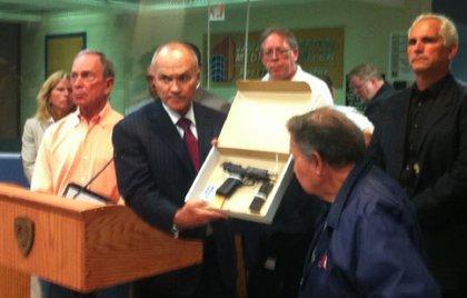 Commissioner Kelly shows the gun found near the scene
