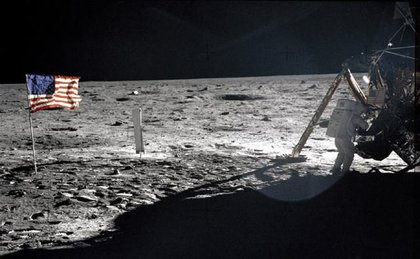 Armstrong stepping onto the moon's surface