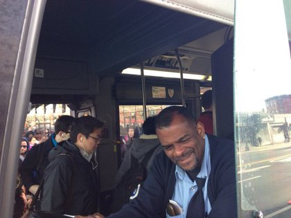 A cheery bus driver