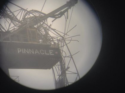 """View of crane through a telescope.. It's already broken off and is def going to fall""—Chris Wade"