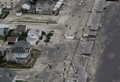 A building sits in the middle of the road in Belmar, N.J.