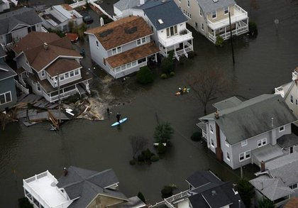Kayakers take to the water to view Hurricane Sandy damage in Belmar, N.J.