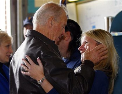 "Biden ""comforts Kim Samarelli during a visit to the Seaside Heights Volunteer Fire Department"""