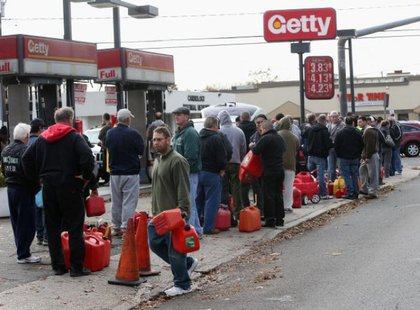 Patrons wait in line to get their gas containers filled on November 2, 2012 in Seaford, New York