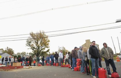 People line up to fill gas canisters at a Shell gas station on November 2, 2012 in Matawan, New Jersey