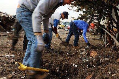 Volunteers help to clean up in the heavily damaged Rockaway neighborhood