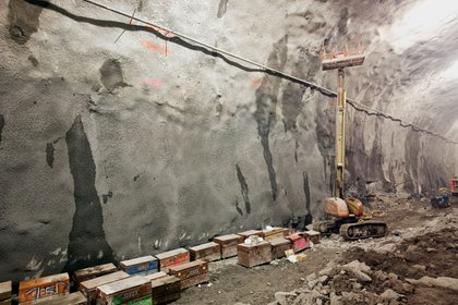 A view of the walls. The entire cavern has to be waterproofed with concrete after it is blasted out.