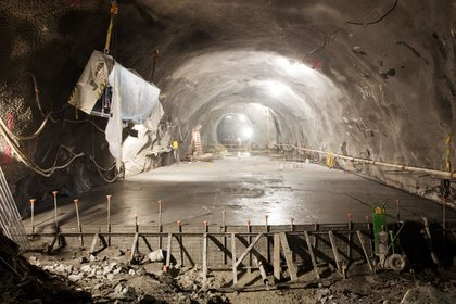 A concrete platform being poured in the East Tunnel.