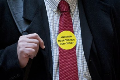 """A """"responsible gun owner"""" wears a sticker."""