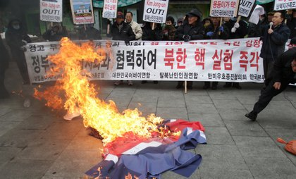 Conservative protesters burn a North Korean flag in Seoul