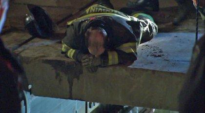 A firefighter observes