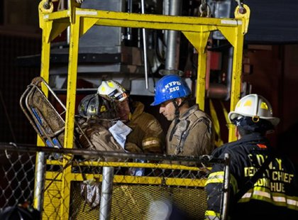 Rescuers in the elevator, going down to the tunnel