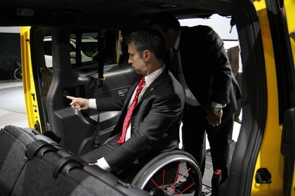 Mayor's Office for People with Disabilities Commissioner Calise inside the taxi