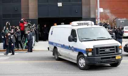 The ME's van leaving Scott's building