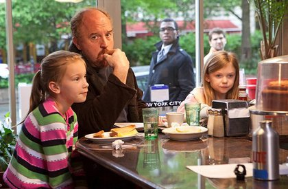 Louis C.K. as his TV alter-ego Louie, with his TV daughters