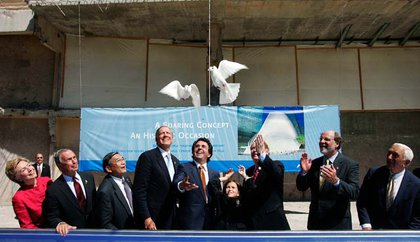 Sofia Calatrava (4-R) daughter of architect Santiago Calatrava releases doves during the ceremony to break ground on the World Trade Transport Hub while Calatrava (5-R) who designed the building in the shape of a bird in flight stands with (L-R) U.S. Senator Hillary Clinton (D-NY), New York City Mayor Michael Bloomberg, U.S. Secretary of Transportation Norman Minetta, New York Governor George Pataki, New Jersey Governor Richard Cody, New Jersey U.S. Senators Jon Corzine (D-NJ), and Frank Lautenberg look on September 6, 2005
