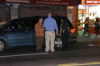 The minivan driver talks to cops