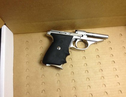 The suspect's gun, recovered at the scene