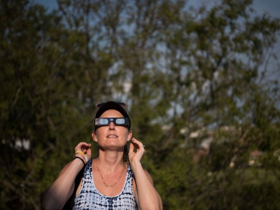 Dana Hamerschlag tests out a pair of eclipse glasses at the South Carolina State Museum August 20, 2017 in Columbia, South Carolina