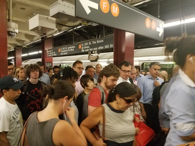 Great job, everyone: Subway passengers leave Rockefeller Center after a classic commute