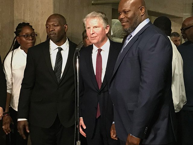 Manhattan DA Vance with Gregory Counts and VanDyke Perry announcing that their convictions would be vacated