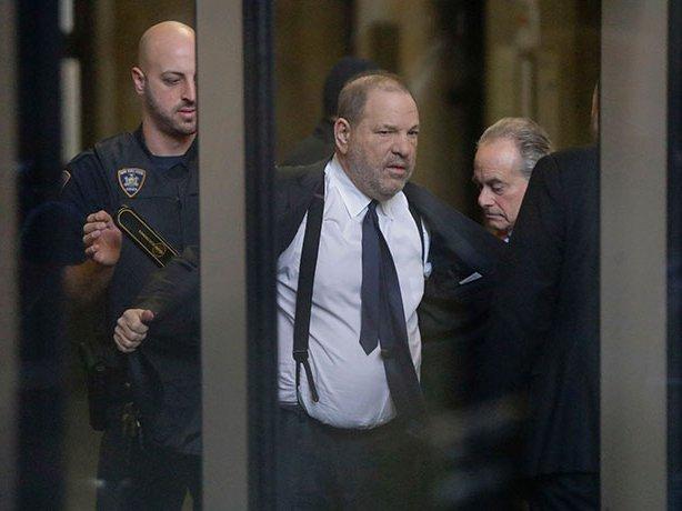 Harvey Weinstein going through security at Manhattan criminal court on December 20, 2018