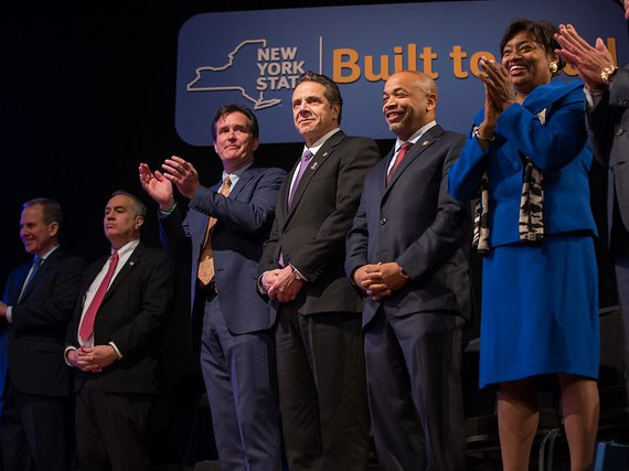 Cuomo in 2016 standing alongside Carl Heastie, right, and Andrea Stewart-Cousins.