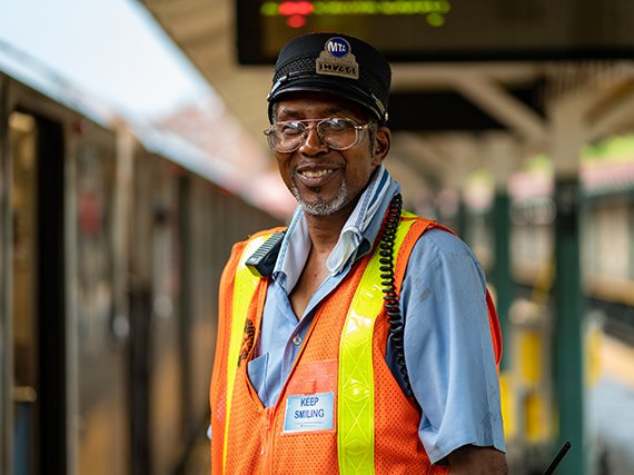 "Kenneth Burton makes passengers feel welcome aboard his ""choo choo."""