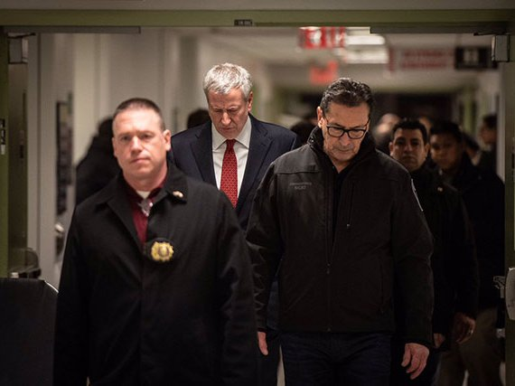 Fire Commissioner Daniel Nigro and Mayor Bill de Blasio head to a press conference about the firefighter's death on Sunday.