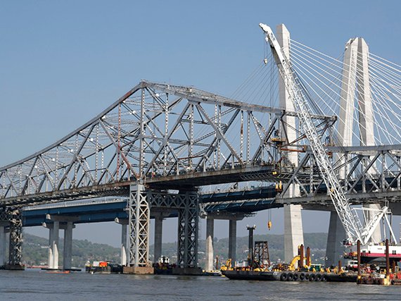 Crews dismantling parts of the Tappan Zee Bridge with the Mario Cuomo Bridge in the background in May 2018